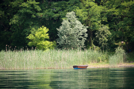 oared boat on a lake bank