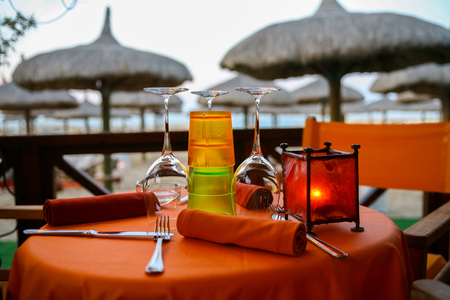 Romantic dinner served for two on a beach Stock Photo
