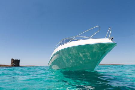 Luxury yatch in turquoise beach of Stintino, Sardinia, Italy Stock Photo