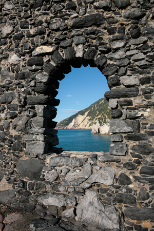 Arched window in a stone wall in Porto Venere, Italy Stock Photo