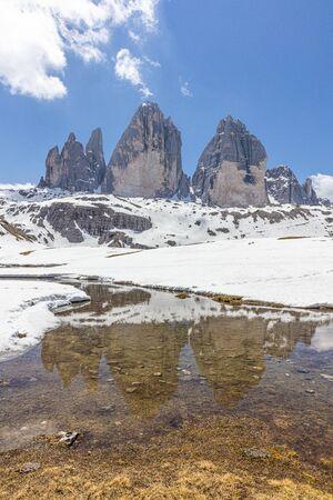 Amazing view of The Three Peaks of Lavaredo (Tre Cime di Lavaredo). Trentino Alto Adidge, Dolomites mountains, South Tyrol, Italy, Europe. UNESCO. Red sky.