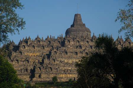 borobudur: Borobudur sunrise with Merapi volcano Stock Photo