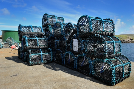 crab pots: Crab fishing cages on a kay in a scottish harbour