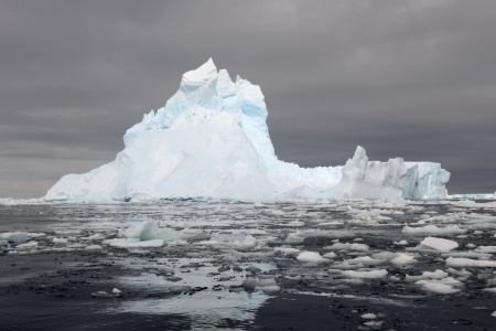 calving: Iceberg at the Ross sea with reflection