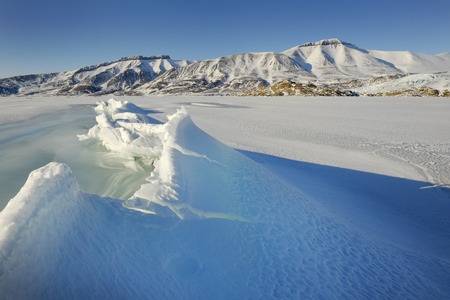 Crack in pack ice in a bay at Spitsbergen  photo