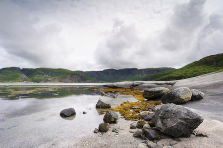 serenety: Rocky coast at an Norwegian fjord