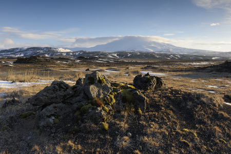 hekla: View on a frozen volcanic landscape with Hekla vulcan in background.