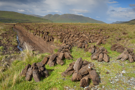 turf pile: Tradition turf industry in Ireland at the westcoast.