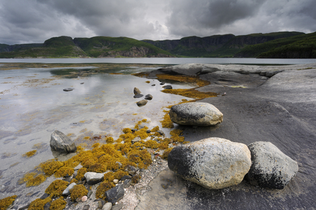 extreme weather: Rocky coast at Norwegian fjord.