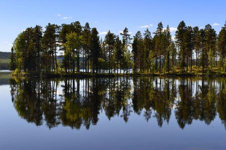 serenety: Swedish lake with reflection.