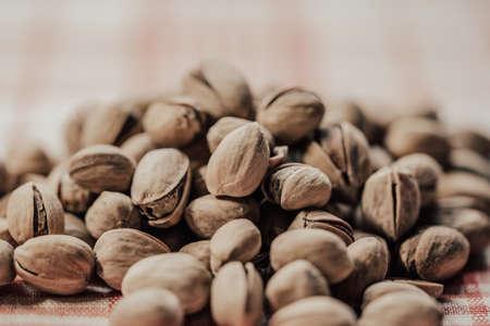 pile of pistachio nuts close-up