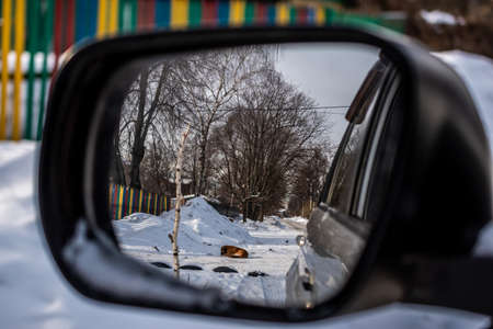 Reflection in the rearview mirror of a car, winter landscape