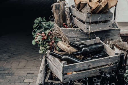 Empty wine bottles in a wooden box and grapes  with space for lettering or design. Stockfoto