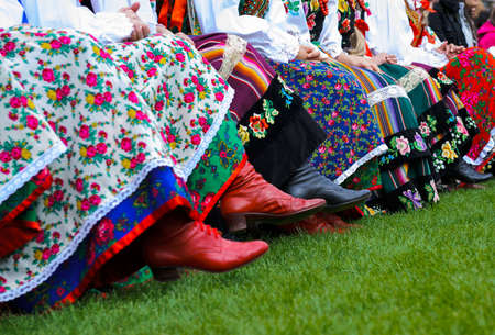 Detail image of girls wearing traditional polish costumes  photo