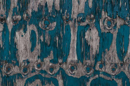 Horizontal color image of abstract close up of peeling paint texture photo