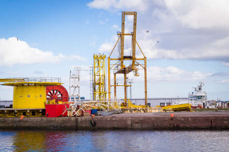 heavy machinery: Horizontal color image of heavy machinery in docks