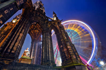 Horizontal colour image of Scott Monument and russian wheel in the background, Edinburgh, Scotland