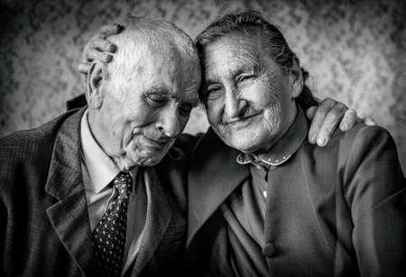 A loving, handsome senior couple  Romantic Senior Couple Hugging  Loving each other forever. Happy retirement concept