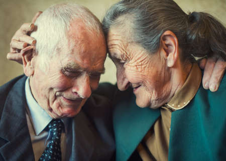 Cute 80 plus year old married couple posing for a portrait in their house  Love forever concept   版權商用圖片