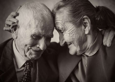 Cute 80 plus year old married couple posing for a portrait in their house  Love forever concept   스톡 콘텐츠