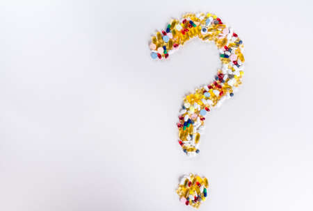 allergy questions: Pills as question mark on white isolated background  Medical concept with copy space