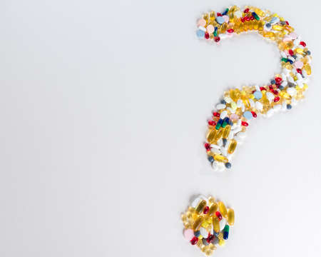 Pills as question mark on white isolated background  Medical concept with copy space photo