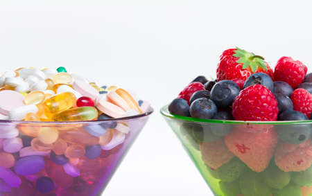microelements: Healthy lifestyle, diet concept, Fruit and pills, vitamin supplements with copy space on white background