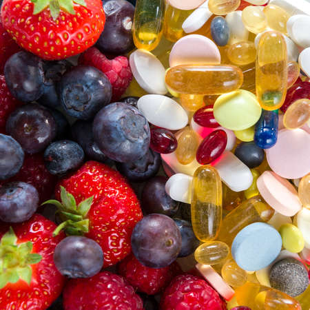Healthy lifestyle, diet concept, Fruit and pills, vitamin supplements with on white background 스톡 콘텐츠