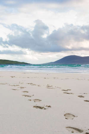 turquise: Footprints in the sand, turquise water and impressive skyes, Luskentyre, Isle of Harris, Scotland Stock Photo
