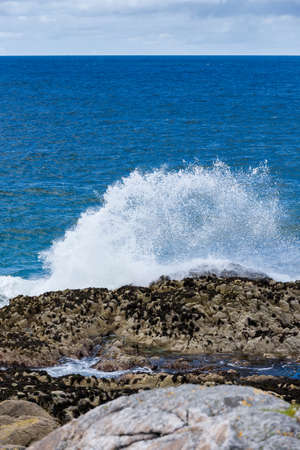 Ocean wave breaking on the sea shore, Luskentyre Isle of Harris, Scotland photo