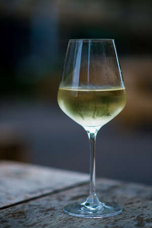 white wine glass: color image of chilled white wine in a glass , with copy space Stock Photo