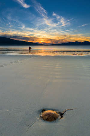 area sexy:  Couple enjoying gorgeous sunset on the beach  Luskentyre, Isle of Harris, Scotland