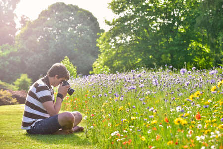 Young handsome caucasian photographer in botanic gardens photo