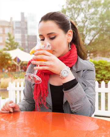 non alcoholic: Attractive young woman enjoying cocktail in an outdoor bar