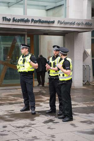 better chances: EDINBURGH, SCOTLAND, UK, September 18, 2014- police men guarding scottish parlament building on independence referendum day