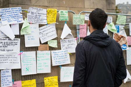 better chances: EDINBURGH, SCOTLAND, UK, September 18, 2014 - man reading handwritten messages regarding Scotland independence on referendum day