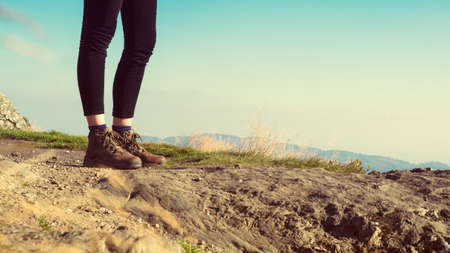 hiking boots: Unrecognizable female hiker on top of the mountain wearing hiking boots, Ben A