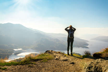 Female hiker on top of the mountain enjoying valley view, Ben A 写真素材