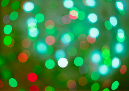 Red and green holiday bokeh. Abstract Christmas background, christmas lights backround Archivio Fotografico