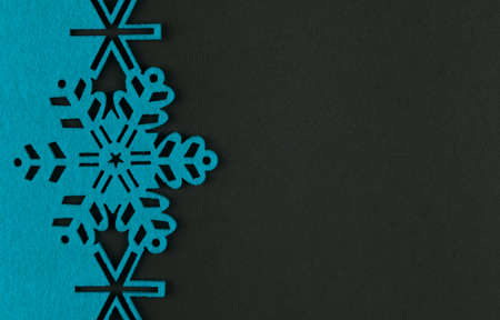 Unusual design christmas background with blue snowflakes and copy space on dark grey background Standard-Bild