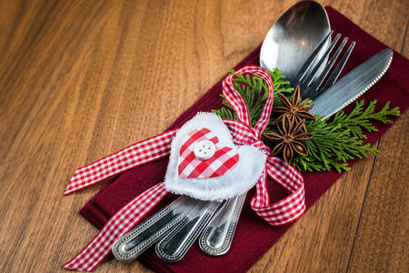 Christmas table setting, christmas menu concept in red, green and white colour tone on wooden table with copy text space photo
