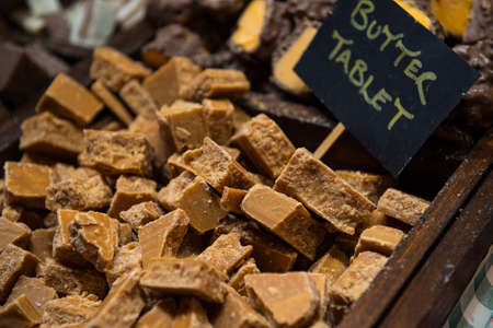 Delicious chunks of homemade butter tablet on display in Edinburgh during christmas market Stock Photo