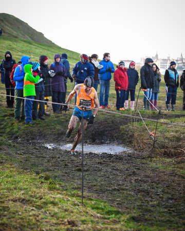 x country: EDINBURGH, SCOTLAND, UK, January 10, 2015 - elite athletes compete in the Great Edinburgh Cross Country Run. This Men Editorial