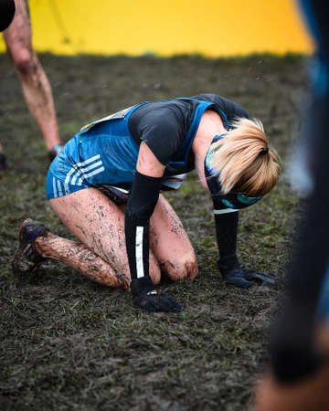 x country: EDINBURGH, SCOTLAND, UK, January 10, 2015 - elite athletes exhausted after the Great Edinburgh Cross Country Run. Woman