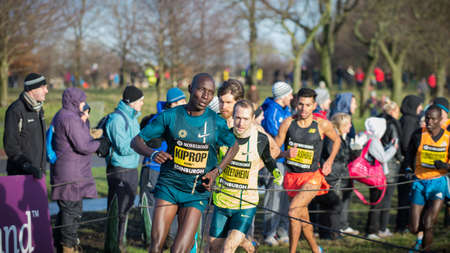 EDINBURGH, SCOTLAND, UK - January 10, 2015 - elite athletes compete in the Great Edinburgh Cross Country Run event, with Asbel Kiprop in the lead. Editorial
