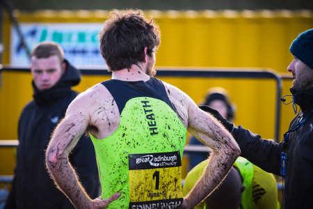 x country: EDINBURGH, SCOTLAND, UK - January 10, 2015 - The Great Edinburgh Cross Country Run event. Garrett Heath, the Men