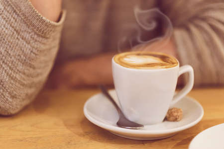 unrecognisable: Detail image of unrecognisable man drinking coffee and having breakfast.