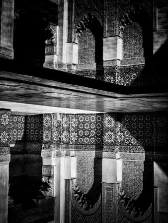 14th century: Marrakech, MOROCCO - February 10, 2012 - Courtyard carvings water reflexions in Ben Youssef Madrasa, Islamic college in Marrakesh founded in 14th century. Editorial