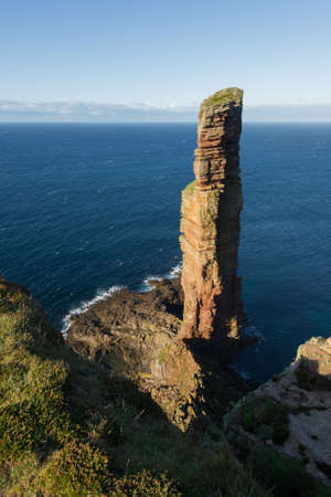 The Old Man of Hoy, sea stack on the island of Hoy, part of the Orkney archipelago off the north coast of Scotland. photo