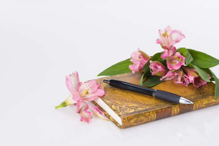 diary and fresh spring flowers on White background and copy space